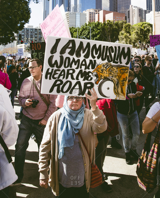 Los Angles, CA - January 21, 2017: Women's march participant holding protest sign �I am Muslim woman, hear me roar�