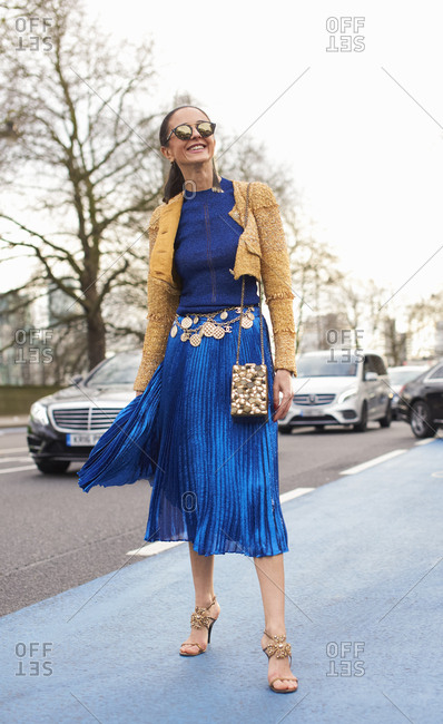 London, UK - February 20, 2017: Full length view of woman leaving Christopher Kane fashion show, London Fashion Week, day four.