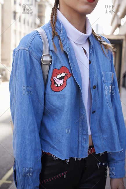 Woman wearing customized denim shirt, crop