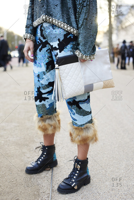 Chic woman in crop trousers carrying large designer handbag