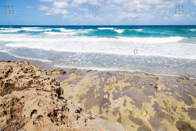 Crystal clear waves crashing on the beach at Blowing Rocks State Park, Hobe Sound, Florida