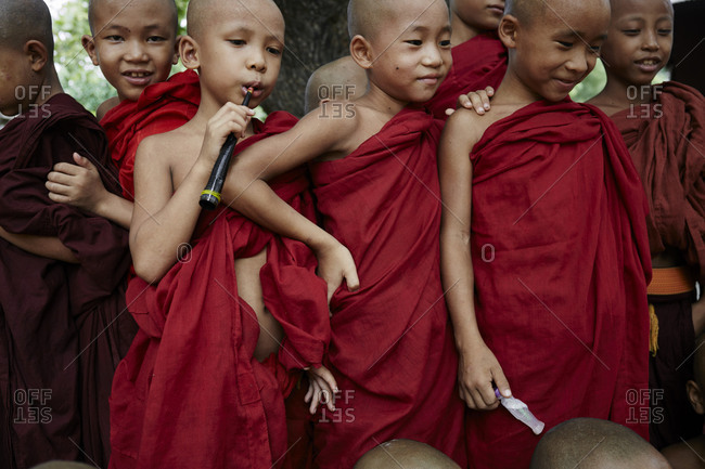 Bagan, Myanmar - August 13, 2015: Young children monks in red robes