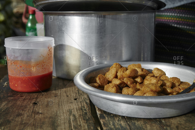 Fried food dish in a metal pan in Mandalay, Myanmar