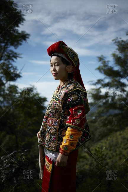 Namhsan, Myanmar - August 8, 2015: Asian woman dressed in colorful traditional clothing