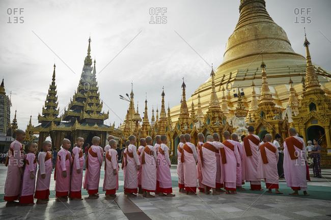 Yangon, Myanmar - August 14, 2015: Young monks at the Shwedagon Pagoda