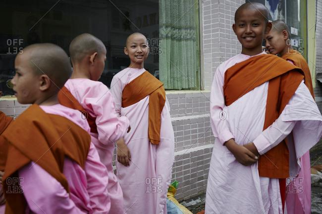 Yangon, Myanmar - August 7, 2015: Young monks in downtown Yangon, Myanmar