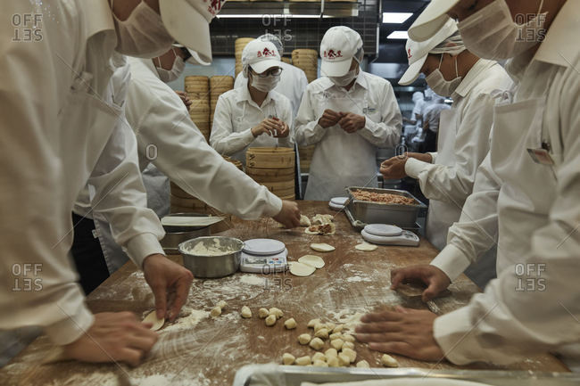 Taipei City, Taiwan - December 23, 2016: Workers in a restaurant preparing food
