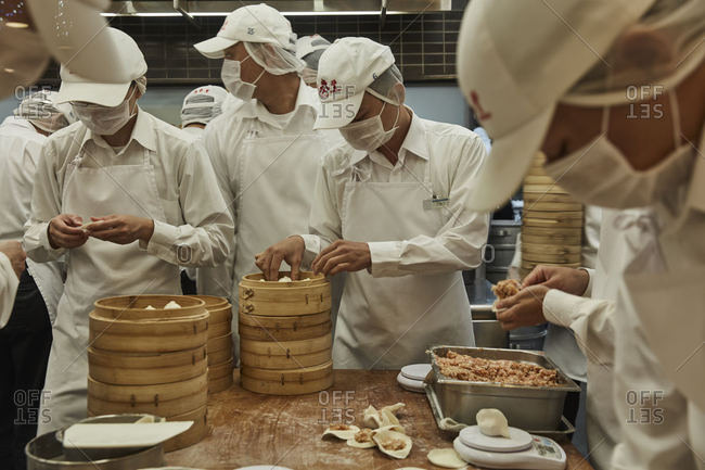 Taipei City, Taiwan - December 23, 2016: Employees in a restaurant preparing food