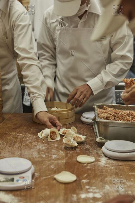Workers in a restaurant preparing food