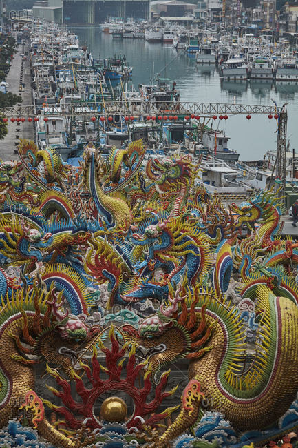 Su'ao, Taiwan - December 22, 2016: View of harbor and roof of Golden Mazu Temple
