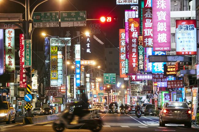 Tainan, Taiwan - December 27, 2016: Busy street downtown at night in Tainan, Taiwan