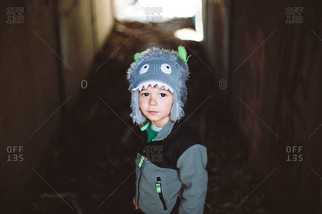Boy in a small underpass in cute hat