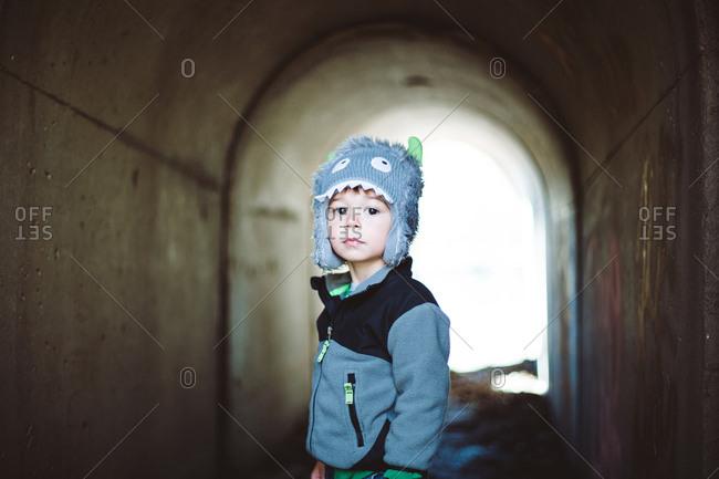 Boy in a small tunnel way