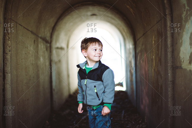 Smiling boy in a small tunnel way