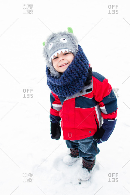 Boy smiling in a winter setting