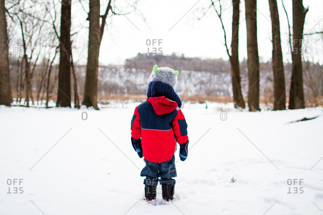 Boy bundled up in winter field