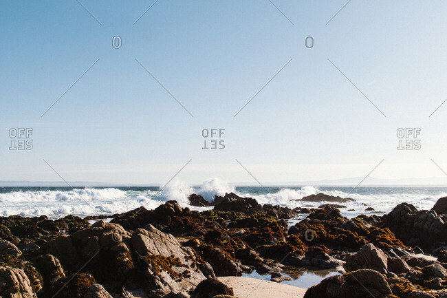 Waves over boulders along shore