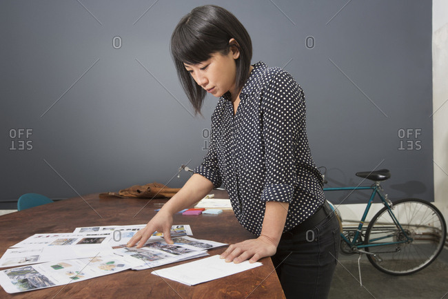 Asian businesswoman examining paperwork