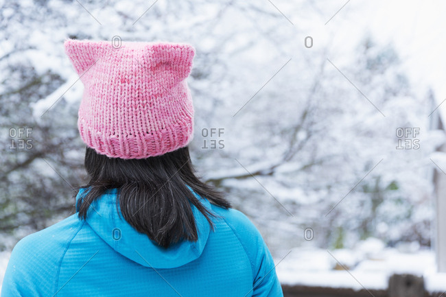 Japanese woman wearing pink hat with ears