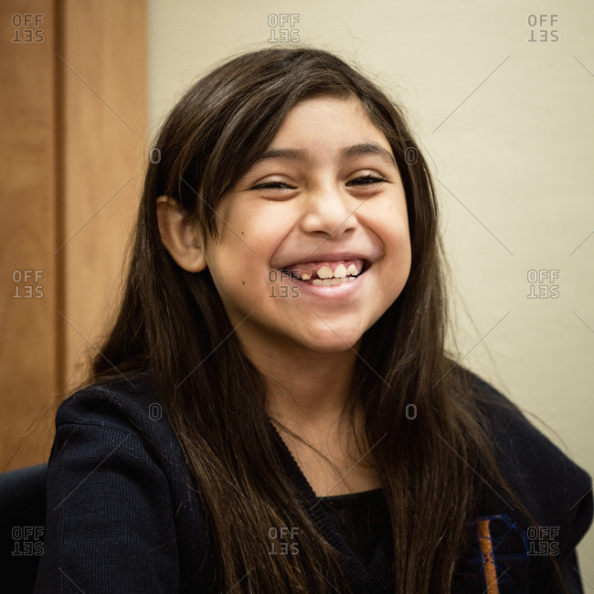 Portrait of smiling Hispanic girl