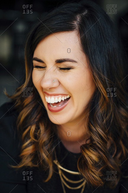 da21d88af9864 ... Portrait of laughing Mixed Race woman with pierced nose