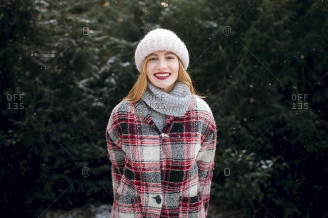 Caucasian woman smiling near trees
