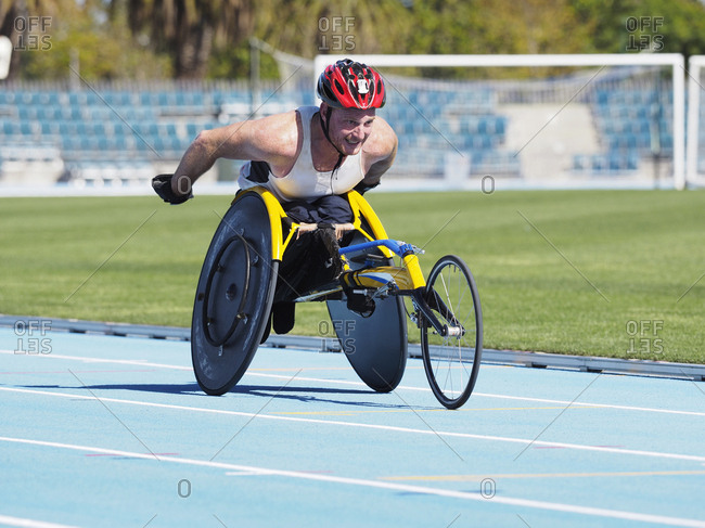 Man racing in wheelchair on track