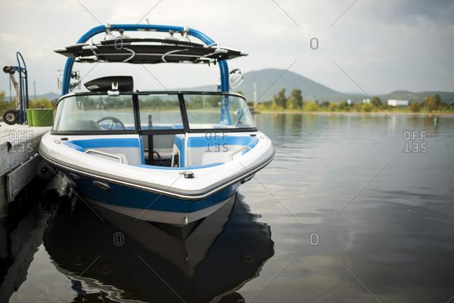 Boat at dock in river