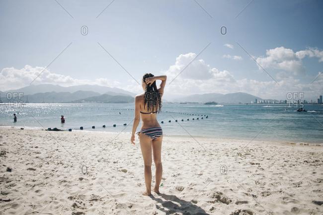 Caucasian woman wearing bikini at beach