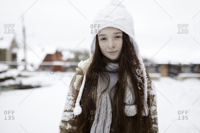 Portrait of Caucasian girl outdoors in snow