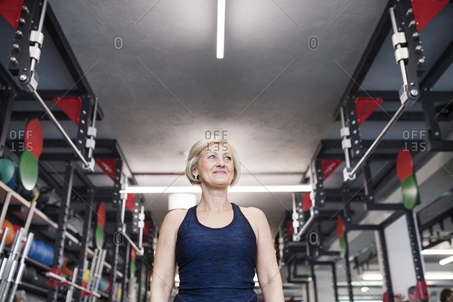 Confident senior woman in gym