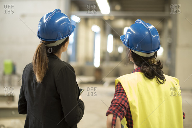 Women working together in concrete factory