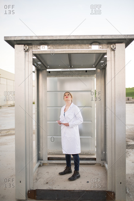 Female scientist checking container
