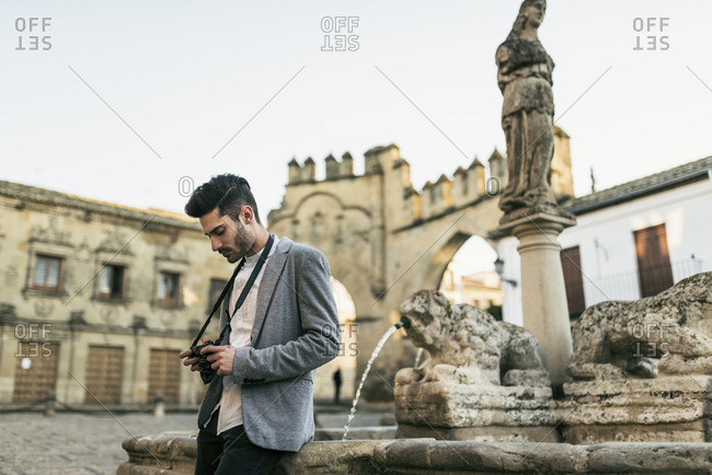Young man taking pictures on a city break
