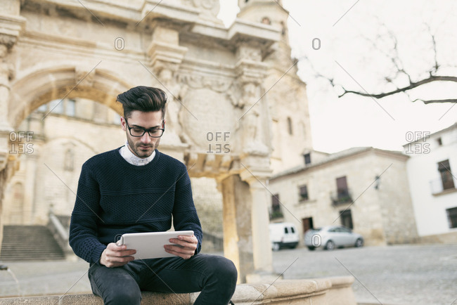 Young man using tablet on a city break