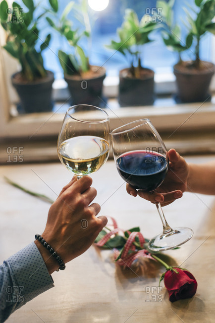 Couple toasting with wine- close-up