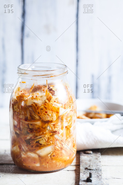 Glass of homemade Korean Kimchi with Chinese cabbage- scallions and carrots