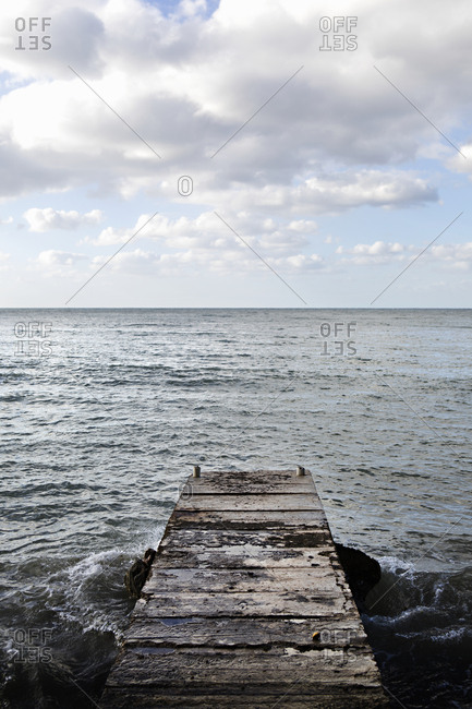 Weathered wooden dock at ocean