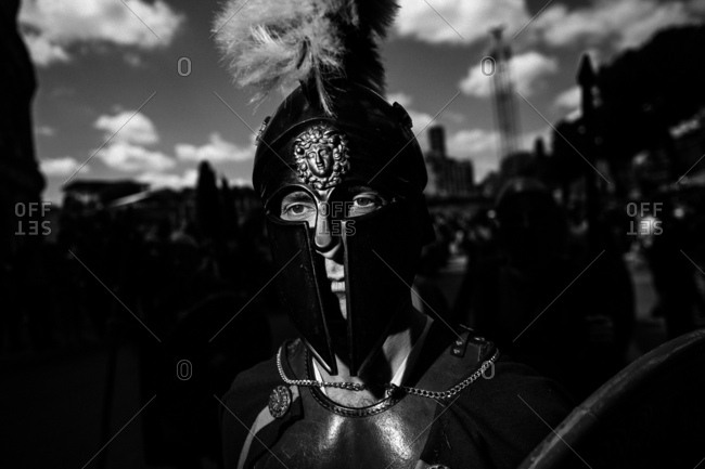 Rome, Italy - April 23, 2017: Portrait of a man in ancient Roman costume wearing a helmet