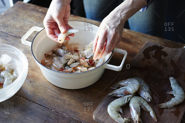 Person removing shells from fresh shrimp