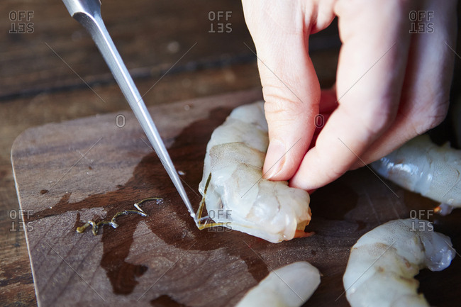 Knife removing vein from shrimp