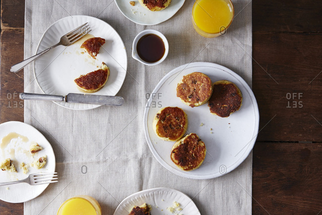 Overhead view of breakfast table with orang-fig-ricotta pancakes