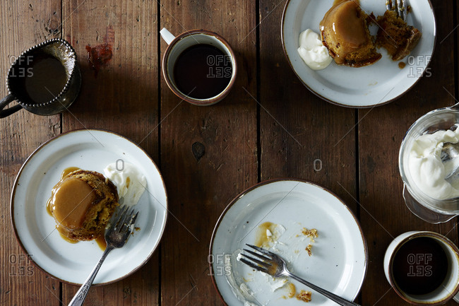 Mugs of coffee with stout toffee puddings