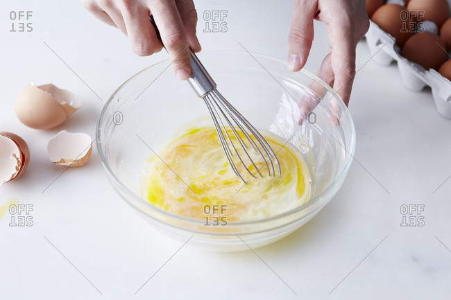 Person whisking eggs