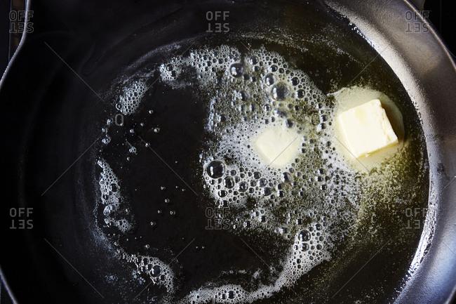 Butter melting in a skillet