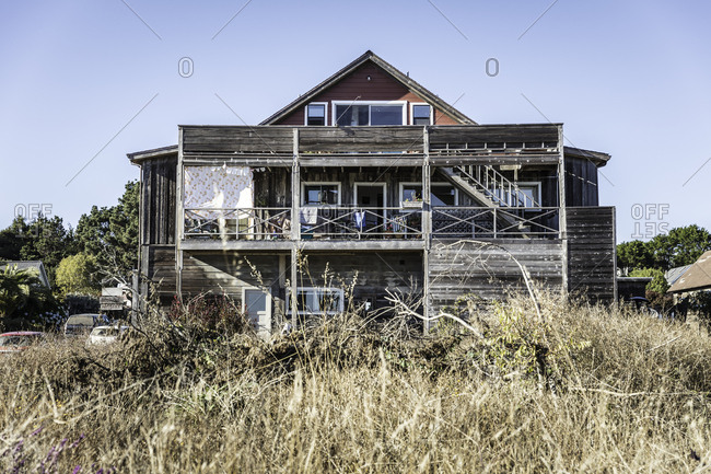 A ramshackle house with an overgrown yard in Mendocino, California