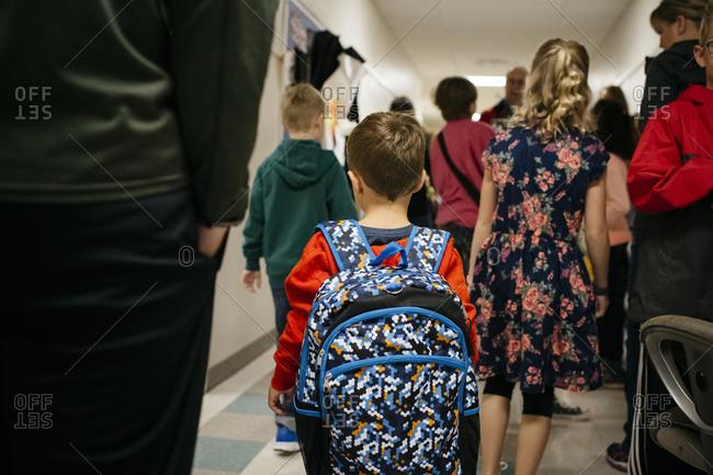 Children walking in the hallway of an elementary school