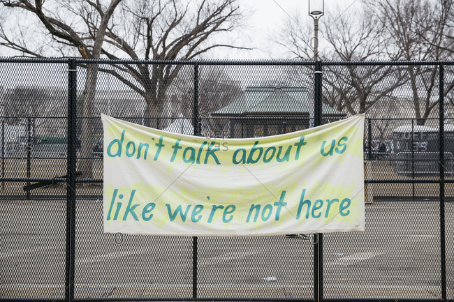Protest sign hanging on a fence from the Women's March on Washington, DC
