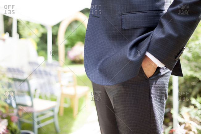 Midsection of bridegroom with hand in pocket