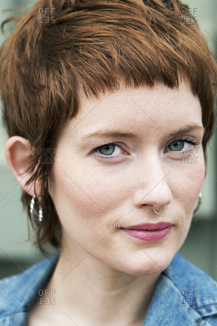 Close-up portrait of confident woman with short hair